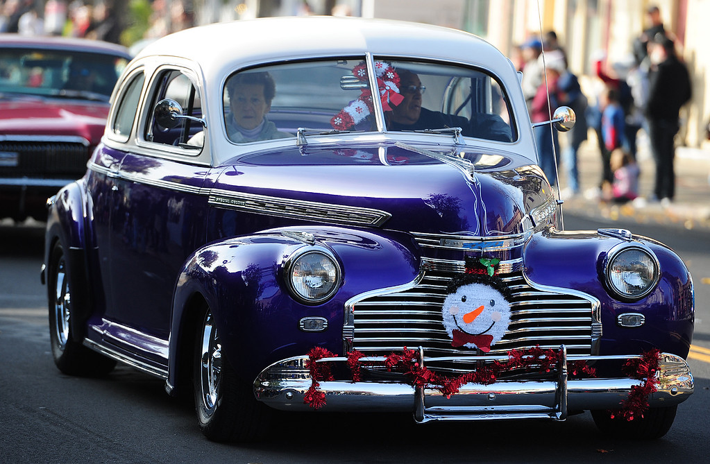 . BENICIA, CA- DEC. 9, A car with the Boyz Under the Hood cruise through downtown during the Benicia Holiday Parade down First Street on Saturday. (CHRIS RILEY/Times-Herald)