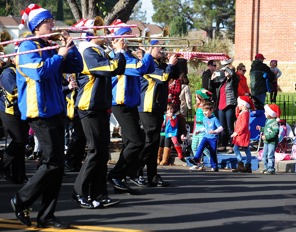 . BENICIA, CA- DEC. 9, Kids dance as the Benicia Marching Band plays during the Benicia Holiday Parade down First Street on Saturday. (CHRIS RILEY/Times-Herald)