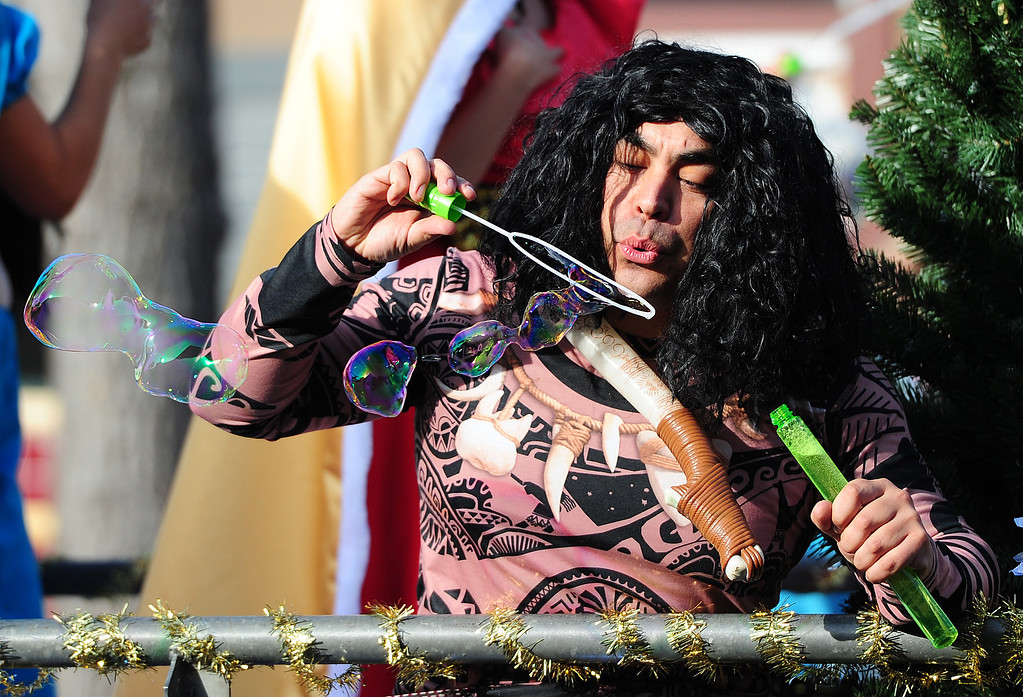 . BENICIA, CA- DEC. 9, Maui fro Moana blows bubbles as he rides with My Once Upon a Time during the Benicia Holiday Parade down First Street on Saturday. (CHRIS RILEY/Times-Herald)