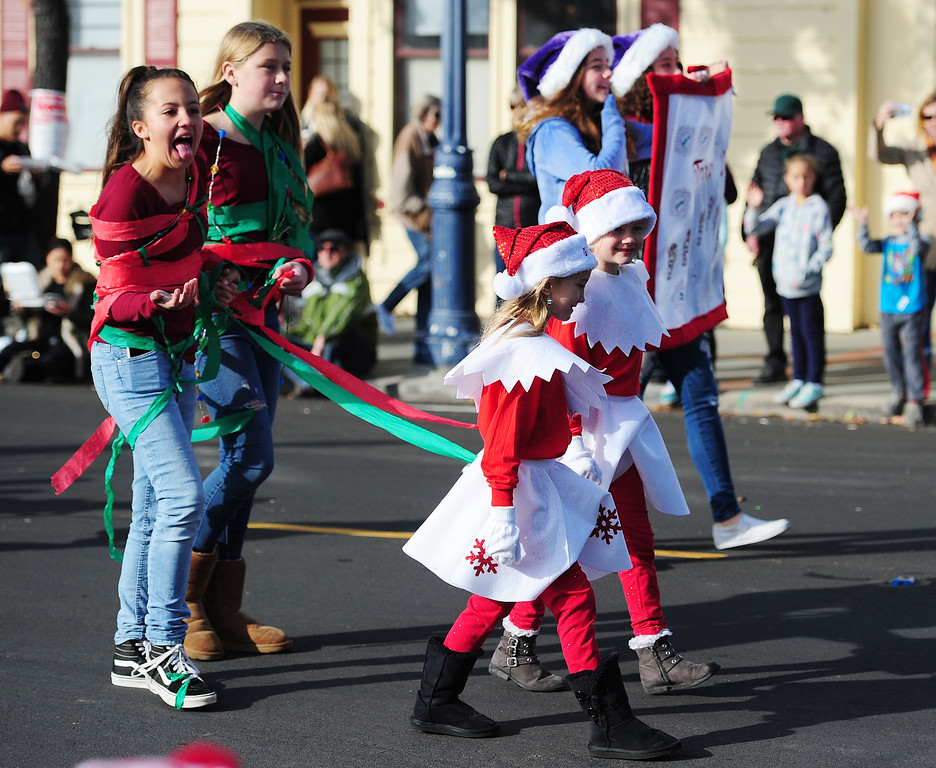 . BENICIA, CA- DEC. 9, Girls Scouts with Troop 20305, dressed as naughty elves walk through downtown with captives during the Benicia Holiday Parade down First Street on Saturday. (CHRIS RILEY/Times-Herald)