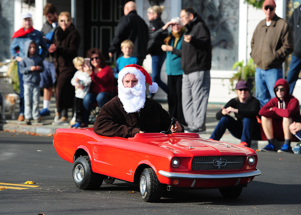 . BENICIA, CA- DEC. 9, A Santa in a Mustang go kart drives with the  Boyz Under the Hood during the Benicia Holiday Parade down First Street on Saturday. (CHRIS RILEY/Times-Herald)