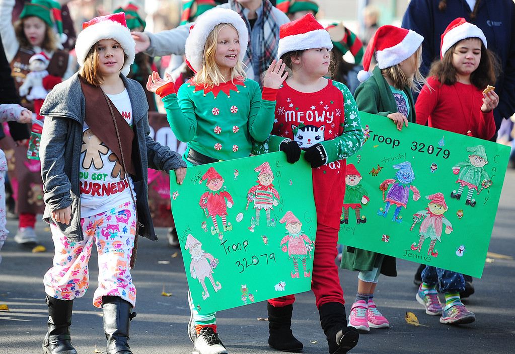 . BENICIA, CA- DEC. 9, Girls Scouts with Troop 32079 walk through downtown during the Benicia Holiday Parade down First Street on Saturday. (CHRIS RILEY/Times-Herald)