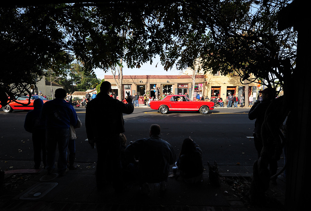 . BENICIA, CA- DEC. 9, A classic Mustang cruises through downtown during the Benicia Holiday Parade down First Street on Saturday. (CHRIS RILEY/Times-Herald)