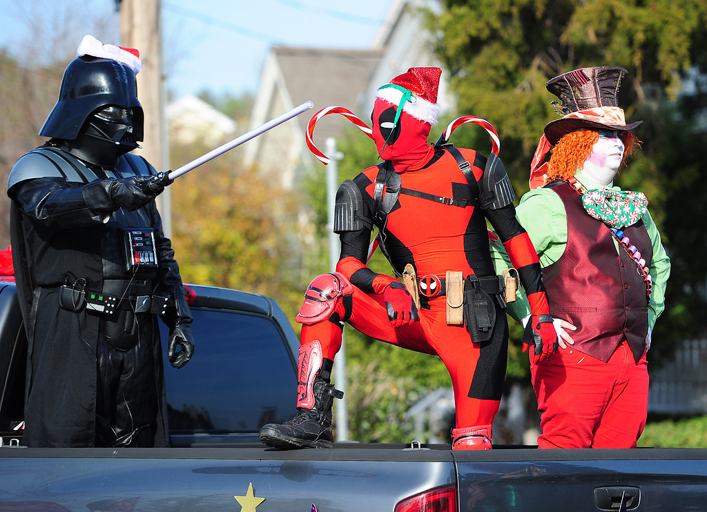 . BENICIA, CA- DEC. 9, Deadpool, played by Adam Serefino rides with Darth Vader, the Mad Hatter and other from My Once Upon a Time during the Benicia Holiday Parade down First Street on Saturday. (CHRIS RILEY/Times-Herald)