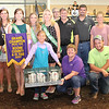 Rod Rose The Lebanon Reporter<br /> RABBIT REWARD: First-year 4-Her Caroline Burkeybyte holds her grand champion meat pen while surrounded by friends, family, buyers and the Boone County 4-H Fair Queen's Court, after receiving $1,000 for the animals at Thursday's Boone County 4-H Fair auction.