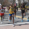 Geoffrey Kirui (left side red/white signlet)  makes his first Boston run a winning one. Falen Rupp (white cap) finished second and Suguru Osako (far left) third.
