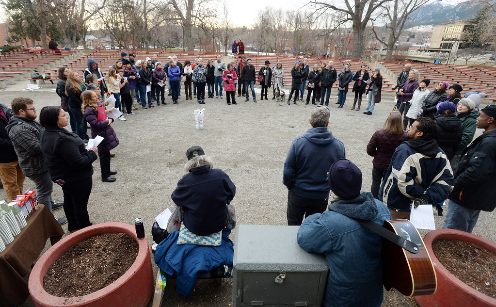 . A circle of people listen to a choir and the names of the people lost this year. The annual Boulder Memorial for the Homeless was held at the Central Park bandshell on Saturday morning.   Cliff Grassmick  Photographer December 16, 2017