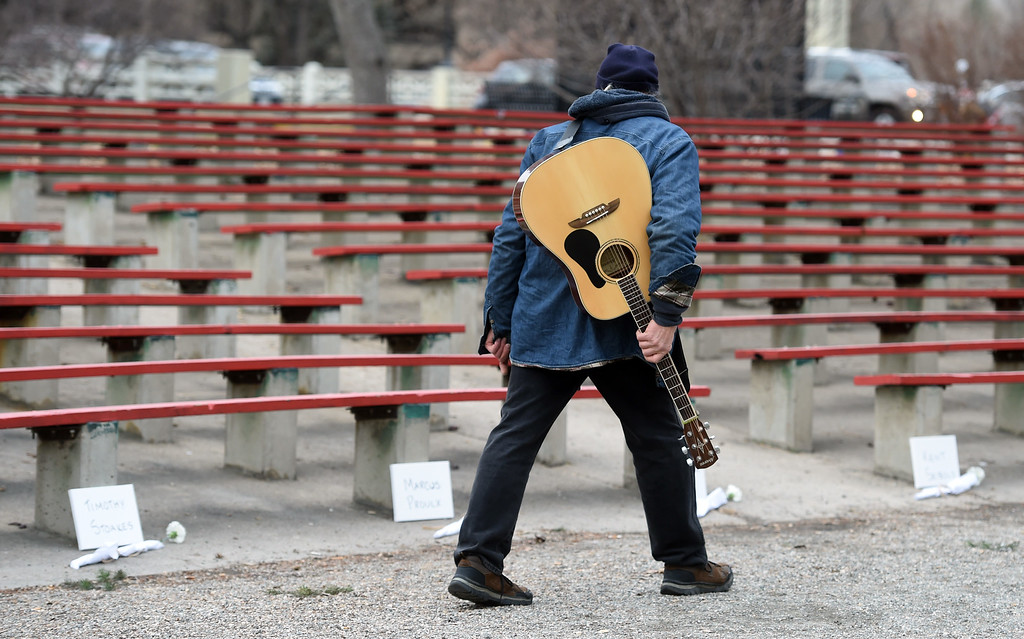 . Steve Tombleson walks by and looks at the names of the homeless people that have died this year. The annual Boulder Memorial for the Homeless was held at the Central Park bandshell on Saturday morning.   Cliff Grassmick  Photographer December 16, 2017