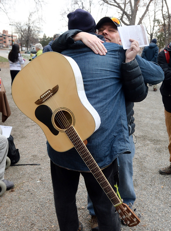 . Steve Tombleson, left, gets a hug from Mike Homner at the ceremony. The annual Boulder Memorial for the Homeless was held at the Central Park bandshell on Saturday morning.   Cliff Grassmick  Photographer December 16, 2017