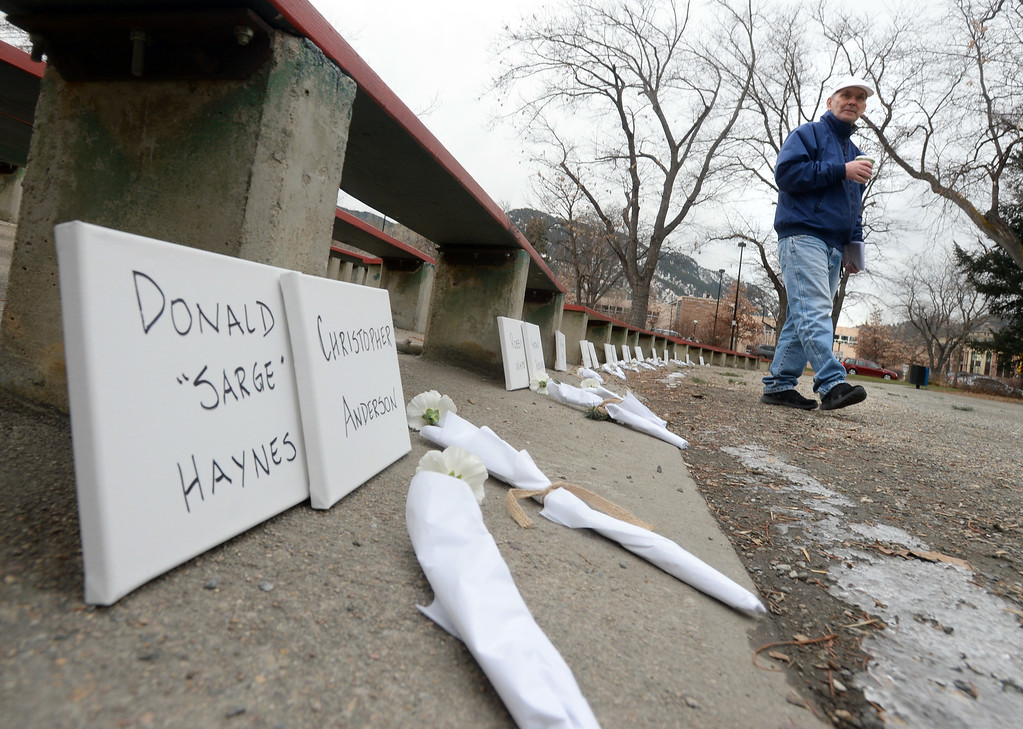 . Michael Fitzgerald walks by the names of homeless people that have died this year. The annual Boulder Memorial for the Homeless was held at the Central Park bandshell on Saturday morning.   Cliff Grassmick  Photographer December 16, 2017