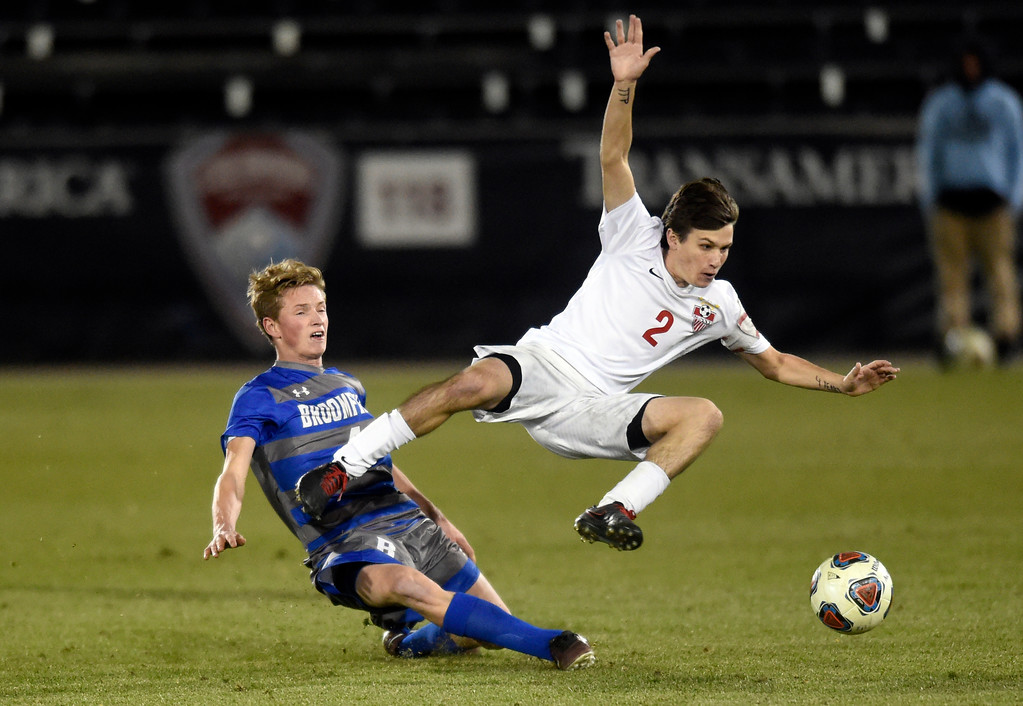 . Broomfield High School\'s Nate Holland slide tackles Sam Carson during the CHSAA 5A State Championship game against Denver East High School on Saturday at Dick\'s Sporting Goods Park in Commerce City. Broomfield won the game 1-0. For more photos go to BoCoPreps.com Jeremy Papasso/ Staff Photographer/ Nov. 11, 2017