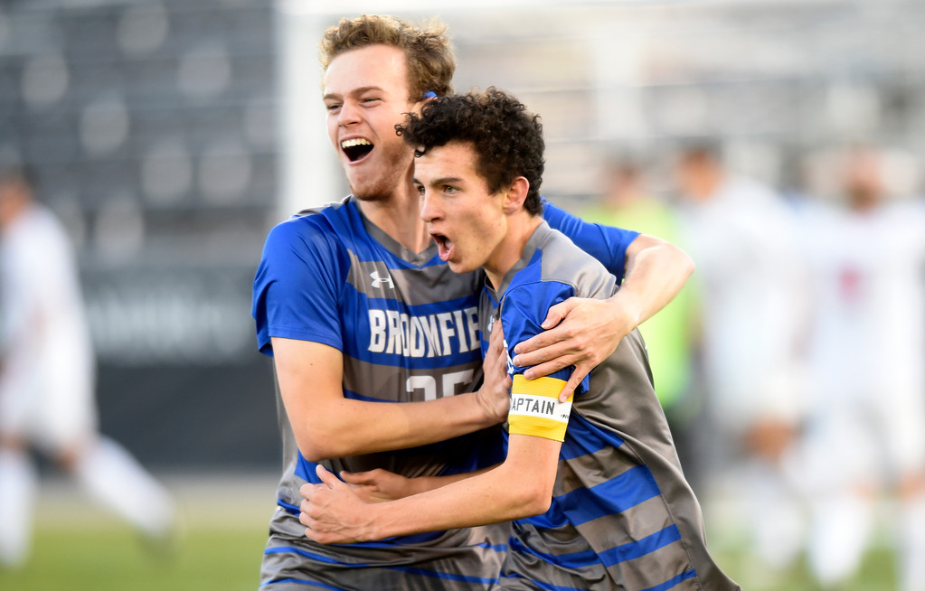 . Broomfield High School\'s Michael Mooney, right, is congratulated by teammate Michael Goergiton after scoring a goal during the CHSAA 5A State Championship game against Denver East High School on Saturday at Dick\'s Sporting Goods Park in Commerce City. Broomfield won the game 1-0. For more photos go to BoCoPreps.com Jeremy Papasso/ Staff Photographer/ Nov. 11, 2017