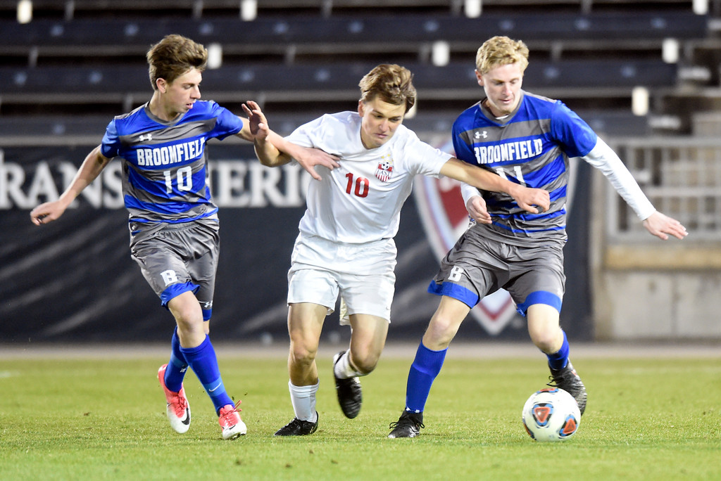. Broomfield High School\'s Triston Austin, left, and Brady O\'Dell try to keep the ball away from Marko Babiak during the CHSAA 5A State Championship game against Denver East High School on Saturday at Dick\'s Sporting Goods Park in Commerce City. Broomfield won the game 1-0. For more photos go to BoCoPreps.com Jeremy Papasso/ Staff Photographer/ Nov. 11, 2017