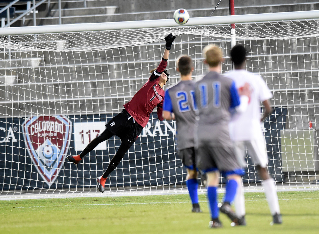 . Broomfield High School goakeeper Jose Ogaz makes a save during the CHSAA 5A State Championship game against Denver East High School on Saturday at Dick\'s Sporting Goods Park in Commerce City. Broomfield won the game 1-0. For more photos go to BoCoPreps.com Jeremy Papasso/ Staff Photographer/ Nov. 11, 2017