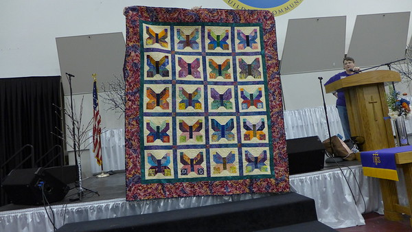 Jan Gagliano showing her butterfly quilt.