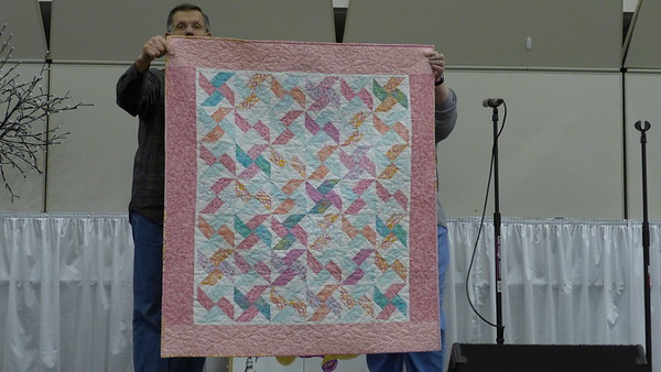 Quilt by Peg Largo.  she has a niece that is expecting a baby in April. Peg was quite happy she had the quilt ready in time for the shower.  Quilting by Nancy Boyse.