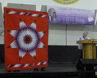 Barbara Obst made this quilt.  It is a quilt of Valor donation.  Radiant Star pattern.  Quilted by Paula ?
