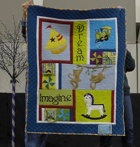 """""""If you like my quilt i am Lon Brewer, if you don't like it, my name is Dan Burke.""""  Lon was onstate with his grandson Merrick."""