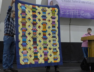 """Jan Gagliano said this quilt was a """"damn attempt"""" to get rid of her scraps.  However the scrap pile still seems the same size.  Qujilt top is going to Bobbi Slider."""