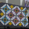 Sharon Wexler purchased this quilt top and pieced back at our guild acution.  Top was made by Carol Meyer, Helen Novak quilted and Sharon did the binding.  It is a donation for Hospice.
