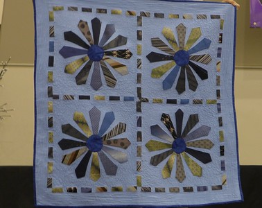 Cathy Smith made this quilt for a friend from the friend's husbands ties.  Quilted by Helen Novak.