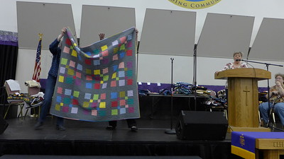 Jan Asmann was challenged to make something that absolute was not her.  So she made this grey quilt.  She went on to explain that the fabrics were purchased in a quilt shop in California that sells fabric very inexpensively.  The sales person did warn Jan that the grey fabric was full price….$3.99 a yard.