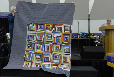 "Nancy Sanchez and solid fabrics came from Dan Burke.  The color fabrics were ""borrowed"" from her sister's closet.  Nancy quilted it herself on her new longarm."
