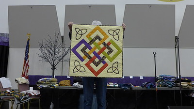 Jean Kaufmann received 4 solid color fabrics as part of a challenge to make for a children's chairty in ohio.  She finished the top but didn't like it until she added the Celtic knots in the corners.
