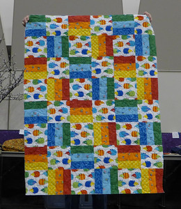 Sharon said a small group that she is working with made this quilt for the Homeless Angels.  Quilted by Mary Hausauer