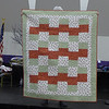 "Sharon told us that she was in St. Louis, Michigan and saw this quilt and siad to the shop owner that it would make a good ""chemo"" quilt.  The owner of the quilt explained to Sharon that her daughter had been th recipient of one of the Chemo quilts at Breslin and she wanted to donate this quilt that had just been finished."