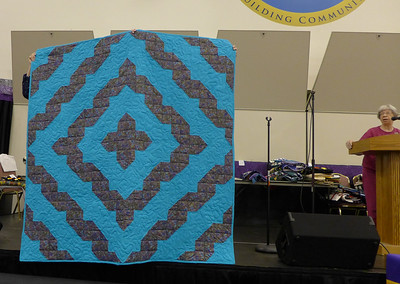 Fran Mort presented this Shaded Nine Patch.  She and Mary made it for the lady that gave Fran her Dog  Quilted by Custom Quilts of Haslett.