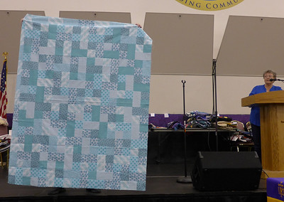 "Jean Kaufmann made this quilt from the ""Kit-in"" sponsored by the guild.  She just kept sewing pieced together until she got a quilt top big enough for a Breslin Chemo quilt."