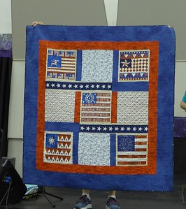 Roseanne Brouwer - showed us a quilt of valor that she is giving to Jackie Beard to help Jackie with her goal of making 100 Quilts of Valor for Portland area veterans.