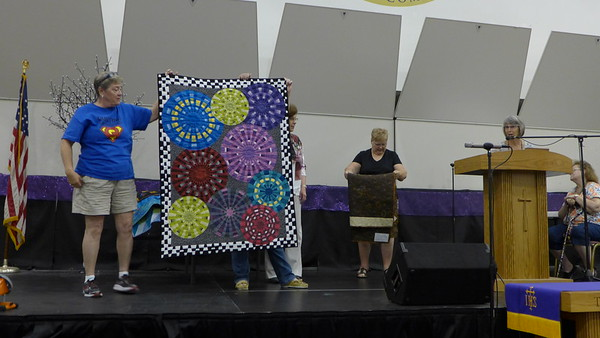 Carol Meyers.  She took a class in Ohio.  she made this quilt from leftovers from the workshop.  She started making wedges, that became circles that became this quilt.  She used up all her pieces from the workshop.  Quilted by Nancy Boyce.