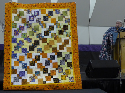 "John Putnam showed his ""Mystery of the disappearing Halloween Nine-Patch"" quilt.  Made for the westside neighborhood festival silent auction.  Quilted by John"