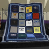 Cindy Reisig showing us a Tee shirt quilt that she made for a customer.  There will be three in the series.  Tee shirt from the customers deceased husband.  Quilted by John Putnam