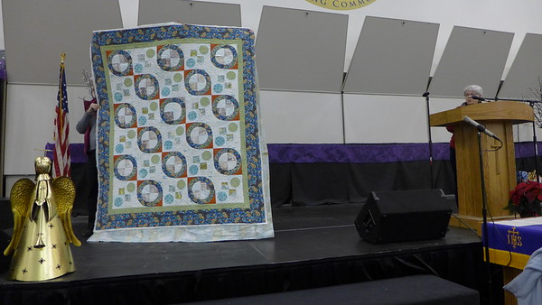 Carolyn Solomon showed a quilt that she made for her son and her son's fiancé.  Pattern is called Dancing Dots and began in the class taught by Nancy Mahoney.  Quilted by John Putnam