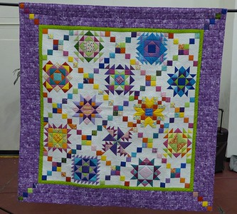 """Quilt by Jan Asmann.  """"Color Sampler""""  size is 78 X 78 and this quilt was machine quilted by Lon Brewer."""