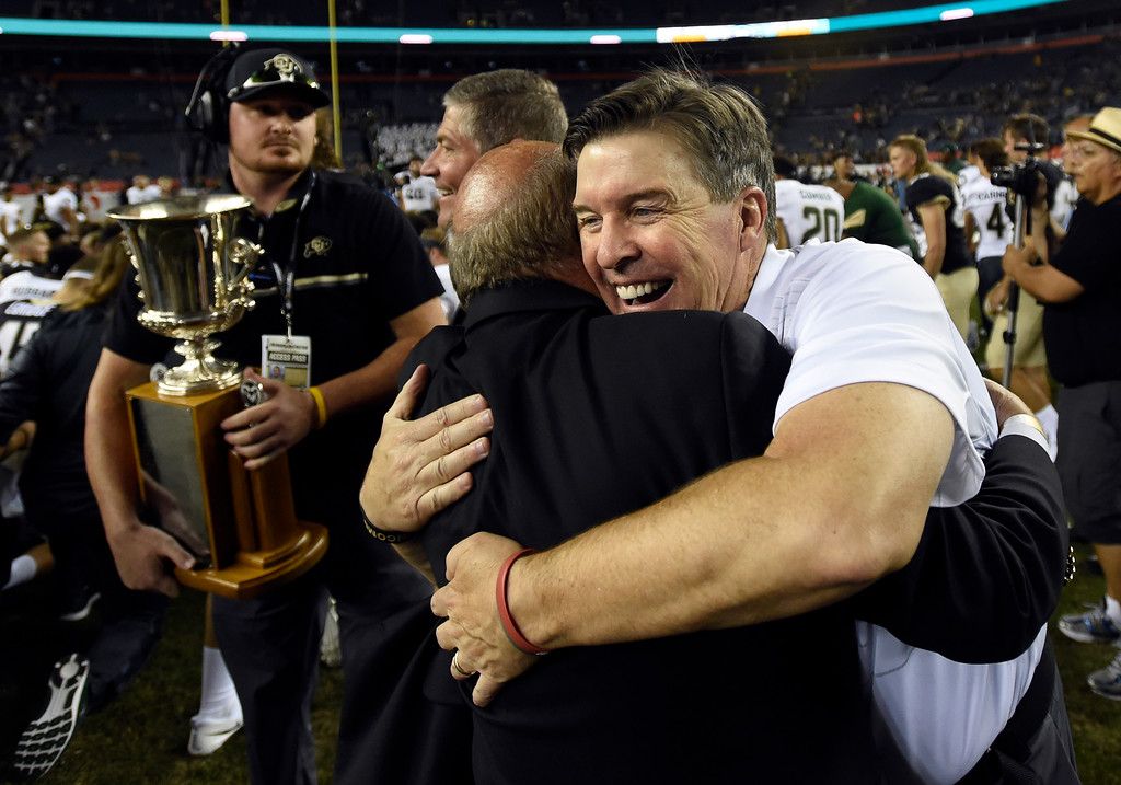 . University of Colorado football head coach Mike MacIntyre hugs Chancellor Phil DiStefano after winning the Rocky Mountain Showdown against Colorado State University on Friday at Sports Authority Field in Denver. CU won the game 17-3. More photos: Buffzone.com Jeremy Papasso/ Staff Photographer/ Sept. 1, 2017