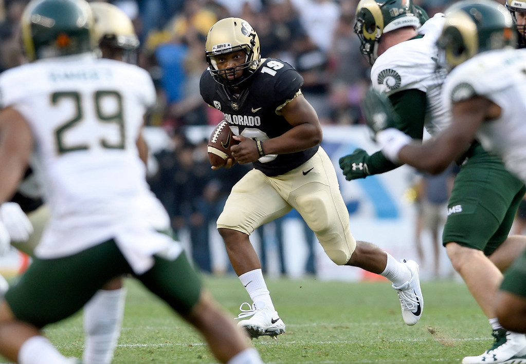 . University of Colorado\'s Michael Adkins II rushes the ball during the Rocky Mountain Showdown against Colorado State University on Friday at Sports Authority Field in Denver. More photos: Buffzone.com Jeremy Papasso/ Staff Photographer/ Sept. 1, 2017