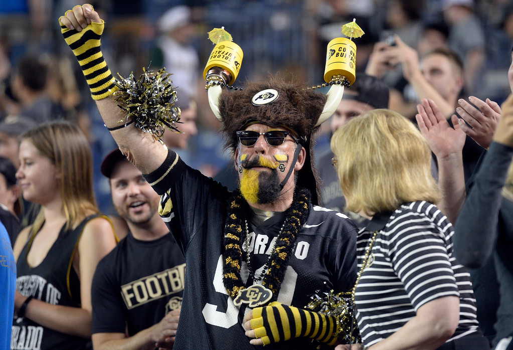 . A University of Colorado fan cheers after a victory during the Rocky Mountain Showdown against Colorado State University on Friday at Sports Authority Field in Denver. More photos: Buffzone.com Jeremy Papasso/ Staff Photographer/ Sept. 1, 2017