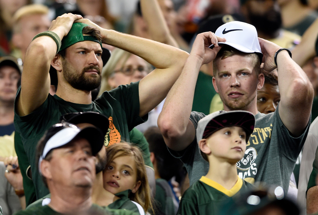 . Colorado State University fans react after a play during the Rocky Mountain Showdown against the University of Colorado on Friday at Sports Authority Field in Denver. More photos: Buffzone.com Jeremy Papasso/ Staff Photographer/ Sept. 1, 2017