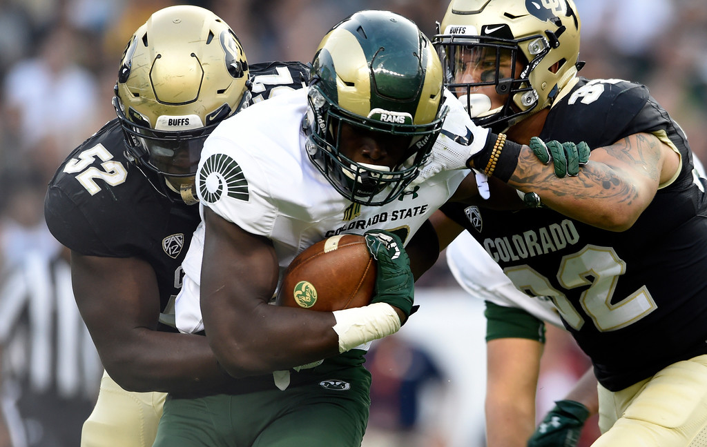 . University of Colorado\'s Leo Jackson III and Rick Gamboa work together to make a tackle on Rashaad Boddie during the Rocky Mountain Showdown against Colorado State University on Friday at Sports Authority Field in Denver. CU won the game 17-3. More photos: Buffzone.com Jeremy Papasso/ Staff Photographer/ Sept. 1, 2017
