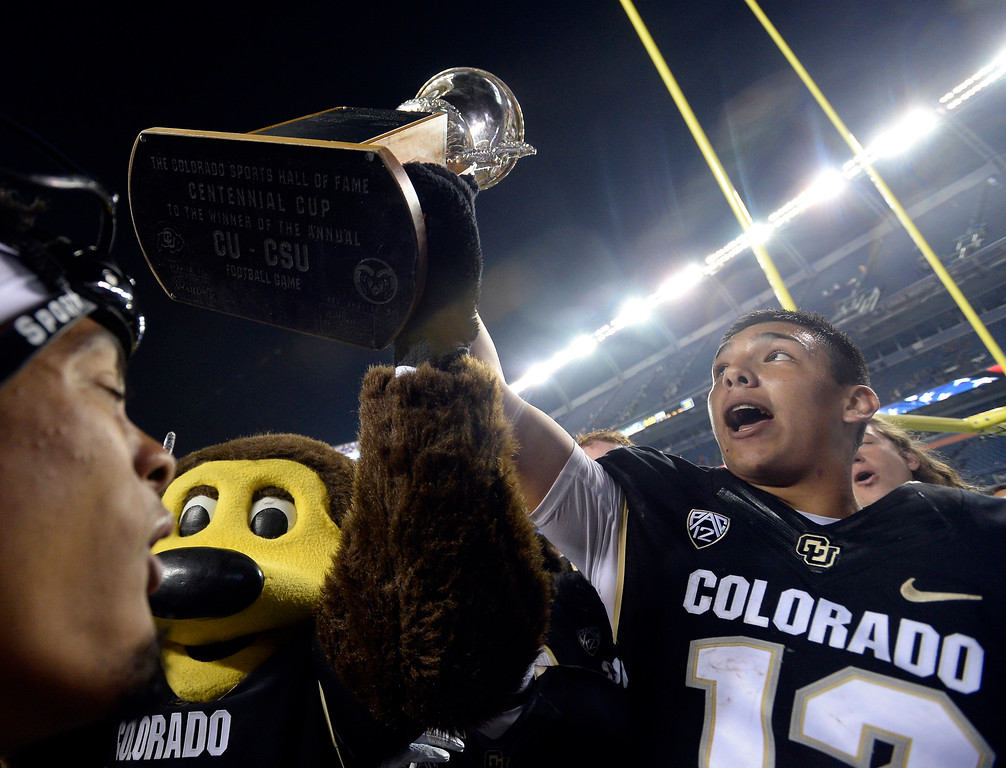 . Chip and Steven Montez hold the Centennial Cupat the end of the Rocky Mountain Showdown in Denver.  Cliff Grassmick / Staff Photographer/ September 1, 2017