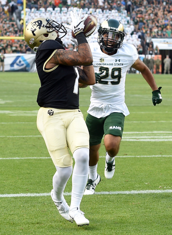 . Shay Fields, of CU, catches a touchdown pass over Justin Sweet, of CSU, during the first half of the Rocky Mountain Showdown in Denver.  Cliff Grassmick / Staff Photographer/ September 1, 2017