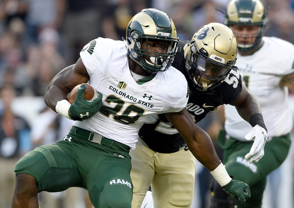 . University of Colorado\'s Leo Jackson III makes a tackle on Rashaad Boddie during the Rocky Mountain Showdown against Colorado State University on Friday at Sports Authority Field in Denver. CU won the game 17-3. More photos: Buffzone.com Jeremy Papasso/ Staff Photographer/ Sept. 1, 2017