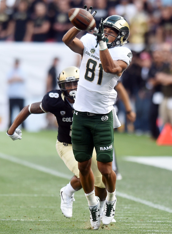 . Olabisi Johnson, of CSU, catches a pass in front of Trey Udoffia, of CU, during the first half of the Rocky Mountain Showdown in Denver.  Cliff Grassmick / Staff Photographer/ September 1, 2017