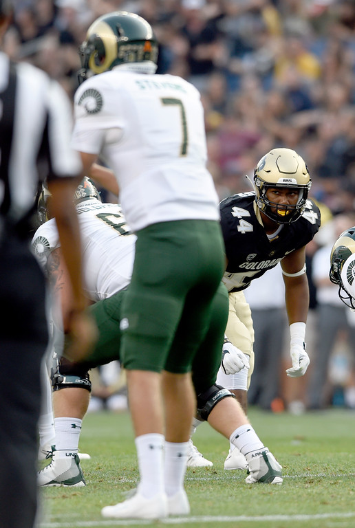 . University of Colorado\'s Jacob Callier waits for the hike to rush the quarterback during the Rocky Mountain Showdown against Colorado State University on Friday at Sports Authority Field in Denver. More photos: Buffzone.com Jeremy Papasso/ Staff Photographer/ Sept. 1, 2017