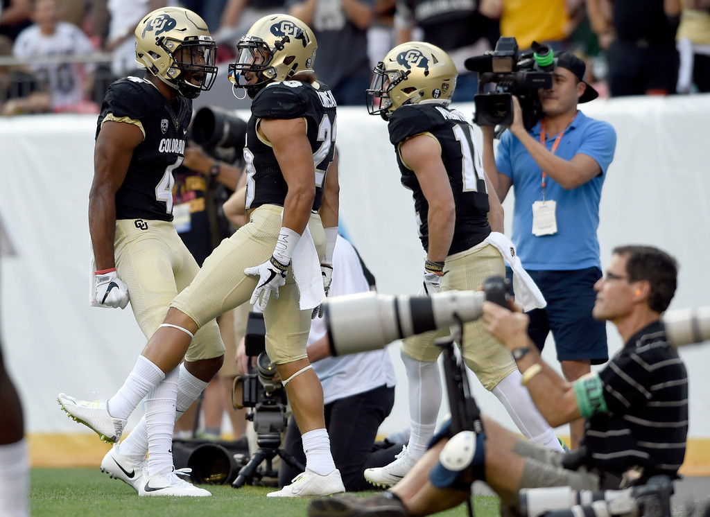 . University of Colorado\'s Phillip Lindsay celebrates a touchdown with Bryce Bobo during the Rocky Mountain Showdown against Colorado State University on Friday at Sports Authority Field in Denver. CU won the game 17-3. More photos: Buffzone.com Jeremy Papasso/ Staff Photographer/ Sept. 1, 2017
