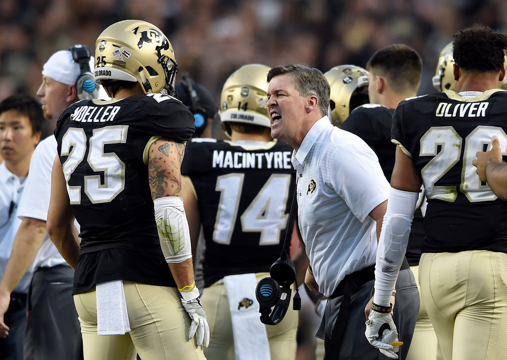 . University of Colorado football head coach Mike MacIntyre yells at Ryan Moeller after a play during the Rocky Mountain Showdown against Colorado State University on Friday at Sports Authority Field in Denver. CU won the game 17-3. More photos: Buffzone.com Jeremy Papasso/ Staff Photographer/ Sept. 1, 2017